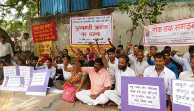 New Sanjay Camp residents at the dharana