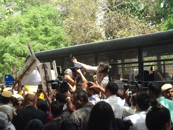 Protestors being bundled into police vans
